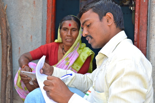 Mobile Health Team worker takes village survey