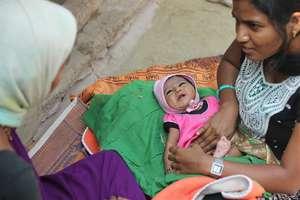 Dr. Pushpa performing routine post-natal checkup