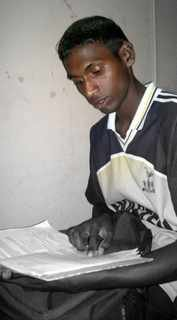 Deva K. engrossed in Home Science