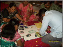 Teachers absorbed in a training session