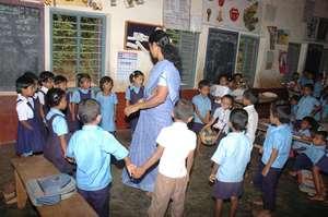 Govt school teacher with children