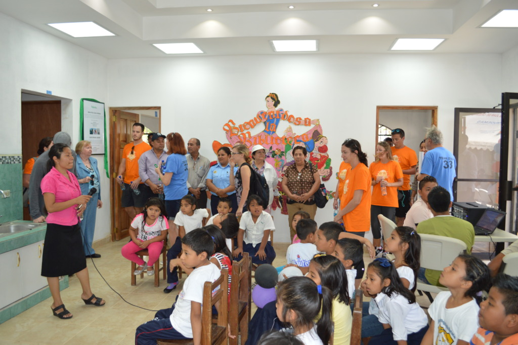 Volunteers and children during reading activity