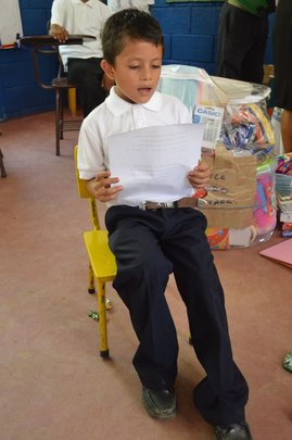 Fabretto student Melvin reads a story in class