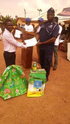 Emmanuel receiving his award