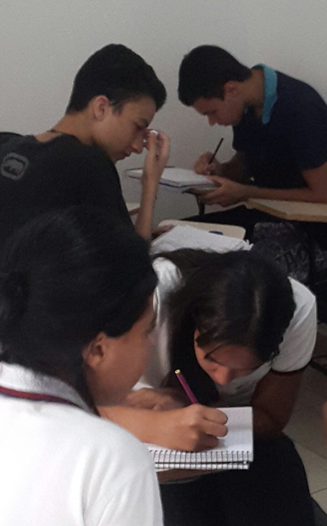 STUDENTS CONCENTRATE ON AN EXERCISE