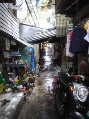 Walking through a slum village in Bangkok