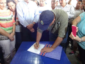 President Solis Signs Decree (Tico Times)