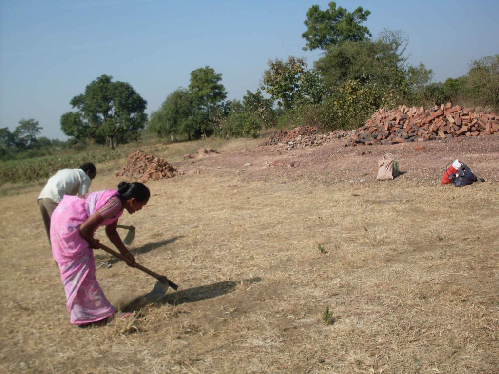 With packed lunch nearby, Geeta preparing the site
