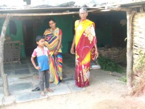 Triveni in front of her home with family.