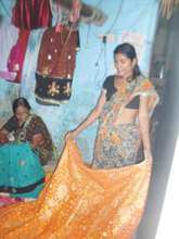 Baby helping her daughter-in-law for self reliance