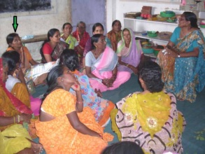 Mangala & women discussing issues of the village