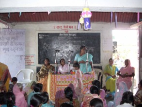 Mangala in centre presiding at a village function