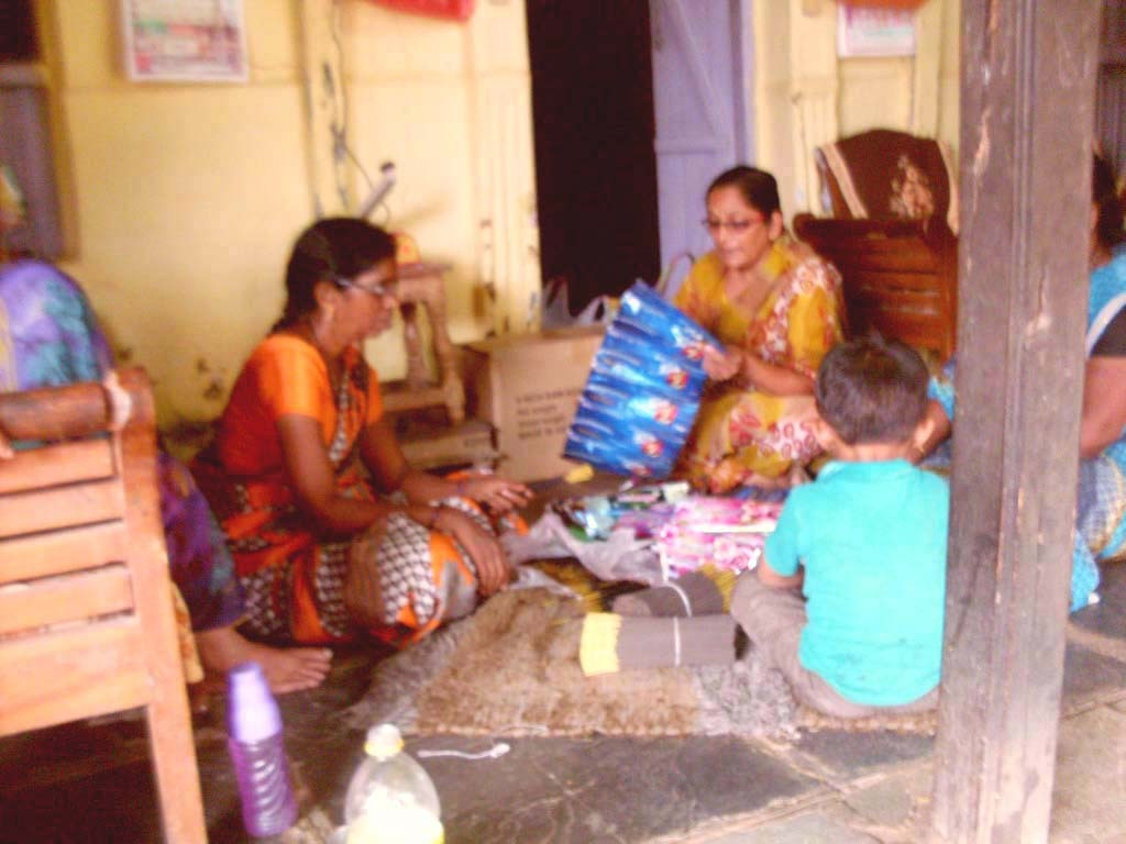 Packing incense sticks for sale with her friends