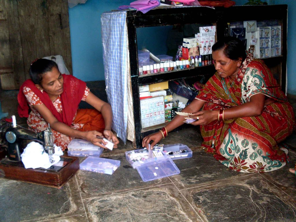 Vandana, sewing clothes & attending a customer