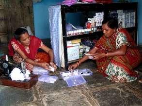 Vandana, sewing clothes & attending a customer