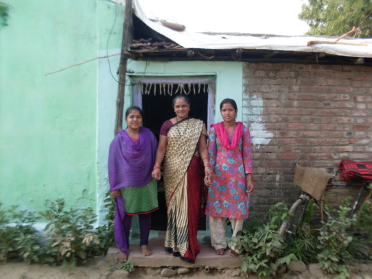Surekha at home with her two daughters
