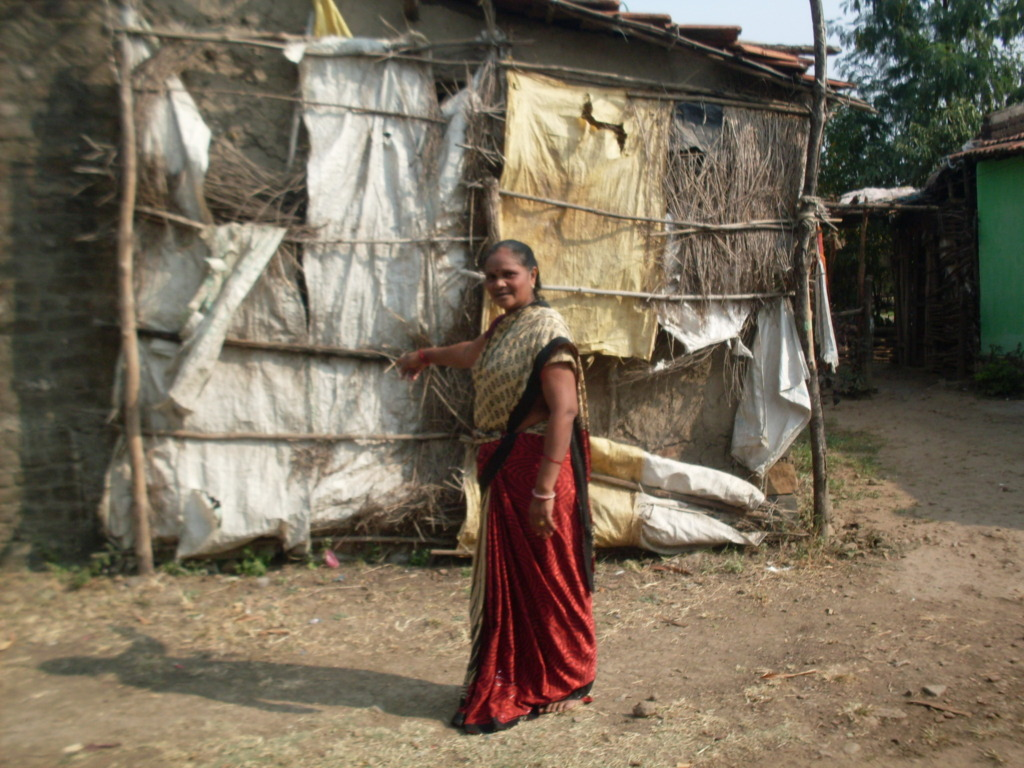 Surekha showing a wall of her house to be repaired