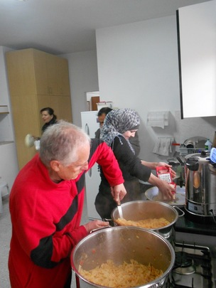 Fr. Bruno cooking for the kids