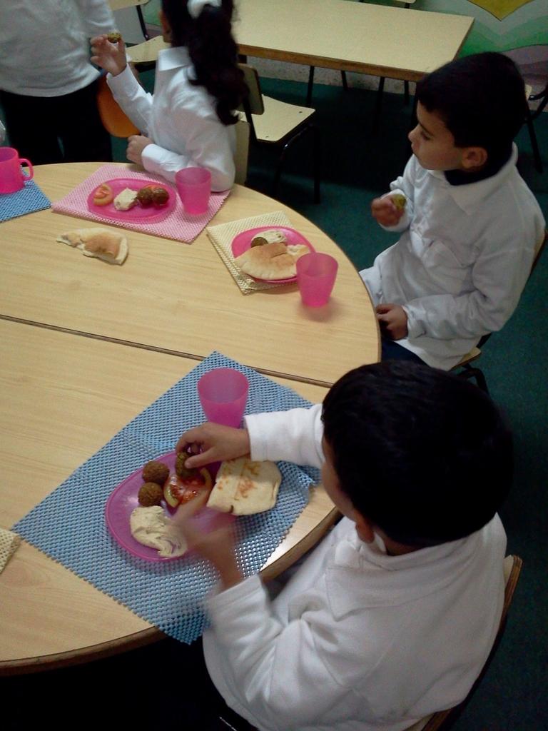 Students enjoying hummus, pita and falafel lunch