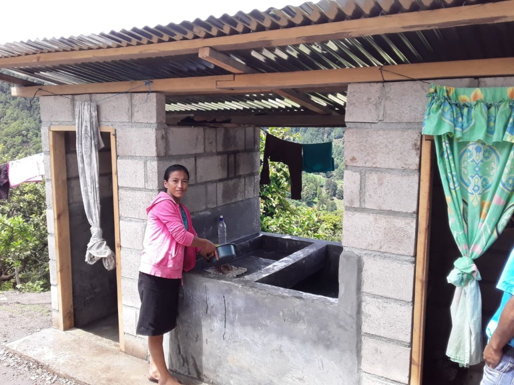 Senora Delmira S. at the latrine and wash station