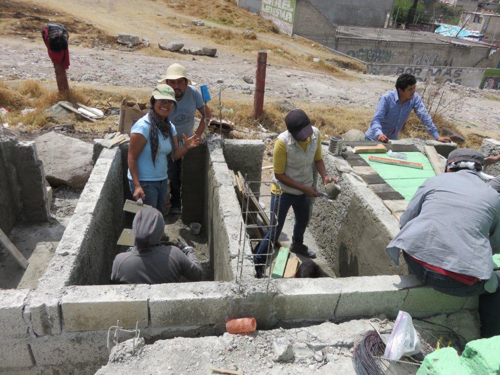 Families helping build the new school latrine