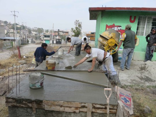 Pouring the floors of the latrines
