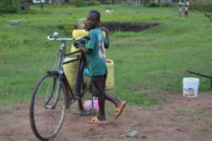 A Child Scambling to Help A Family with Water