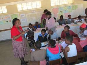 Linda, DfGZimbabwe director teaching Luveve school