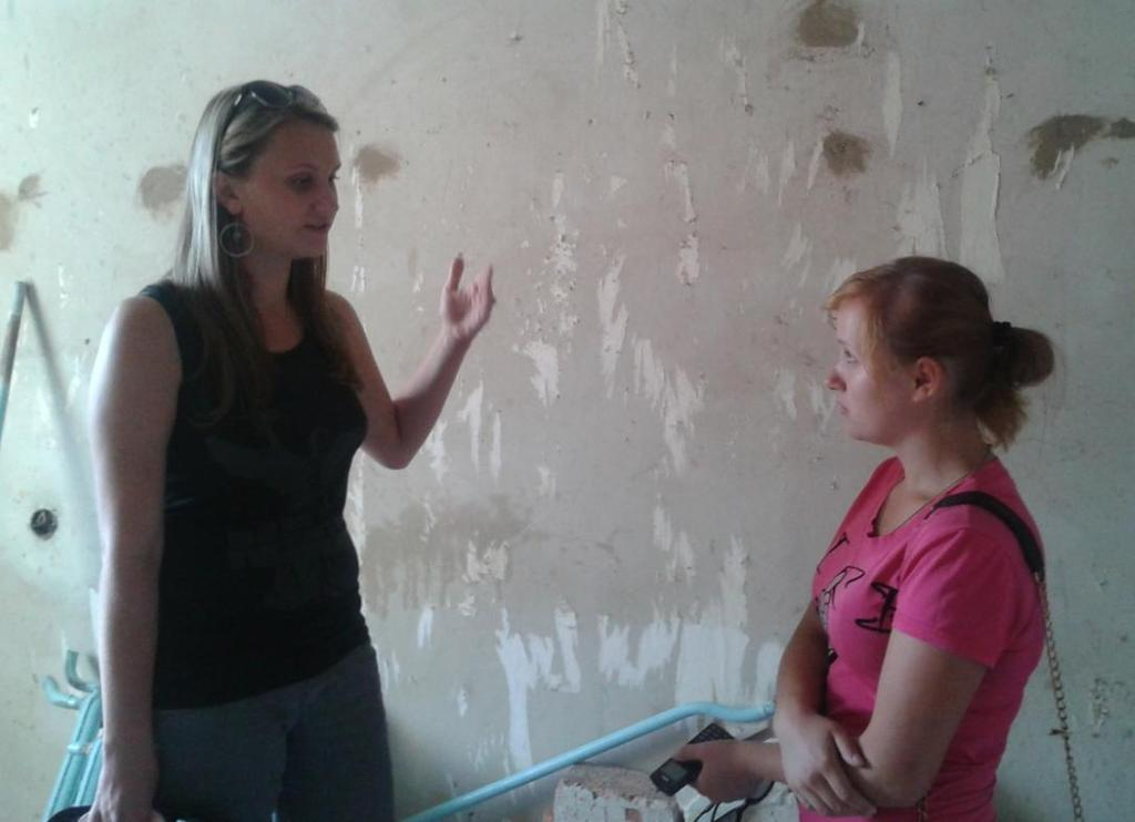 Discussing renovation plan with social worker