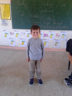 Boyaci Village School kid got his new sneakers
