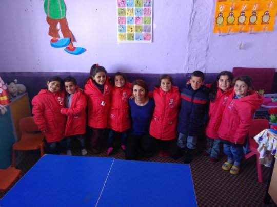 Teacher Esra with her students