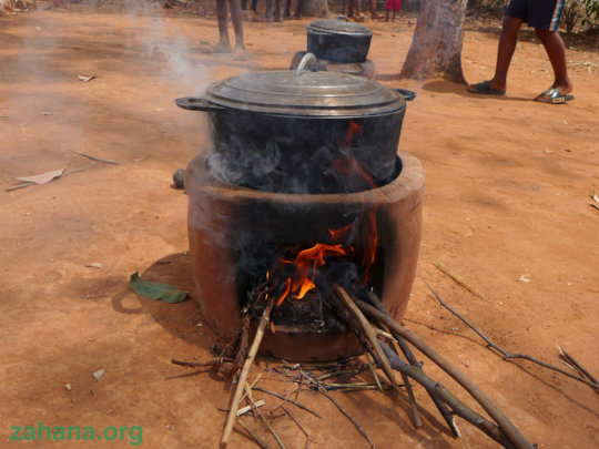 An impoved cookstove in action outside