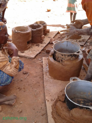 Making improved cookstoves in the community