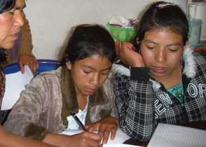 Clara and Glenda writing letters to their sponsors
