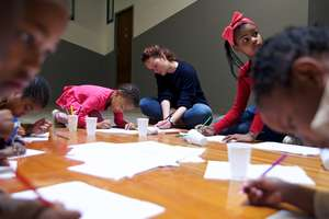 Melanie, founder of Streetlight Schools with kids