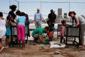 Melanie and volunteers working with kids