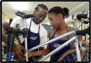 Retail staff learn about basic bike maintenance.