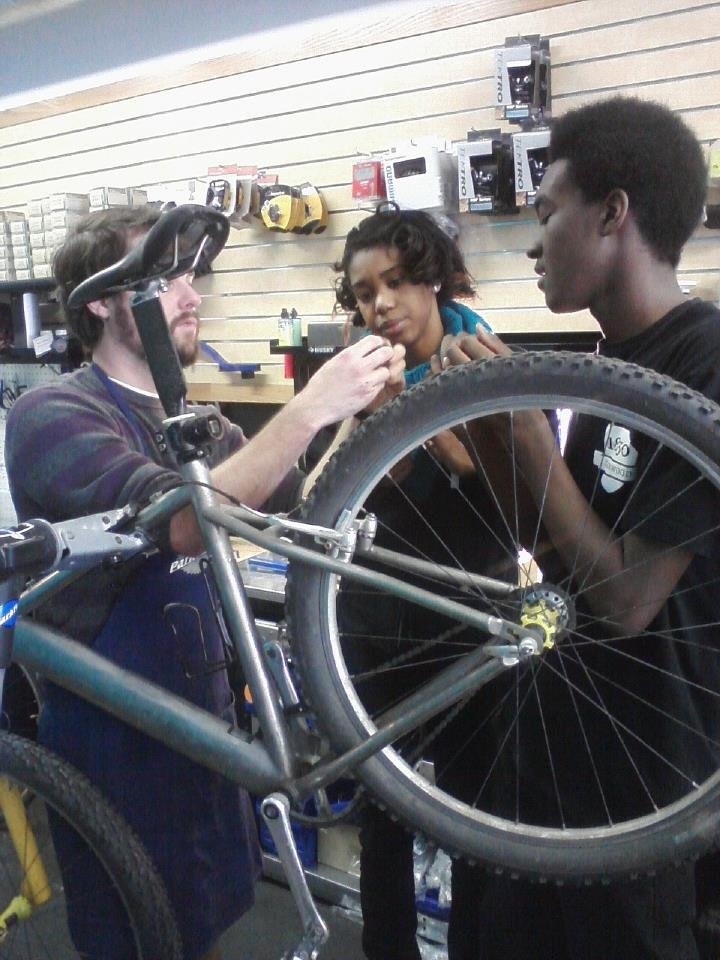 Retail Lab interns learn about basic bike repair