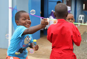 Children celebrating before the ribbon cutting