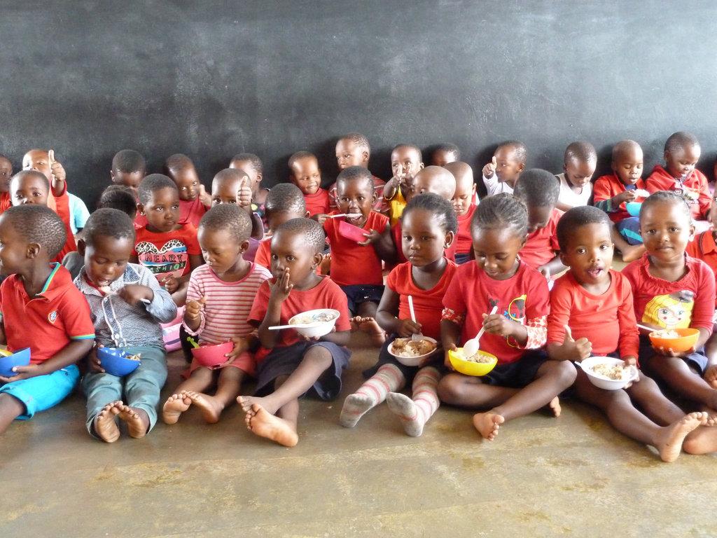 Children at Siyabonga Enjoying Breakfast