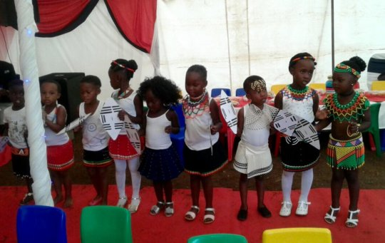 Children Performing at Graduation Celebration