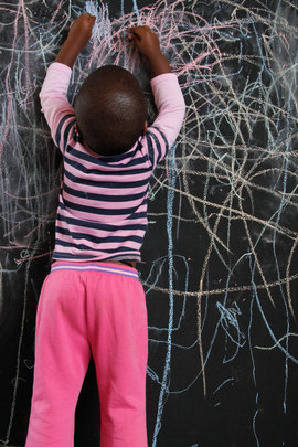 A student enjoying our new chalkboard walls
