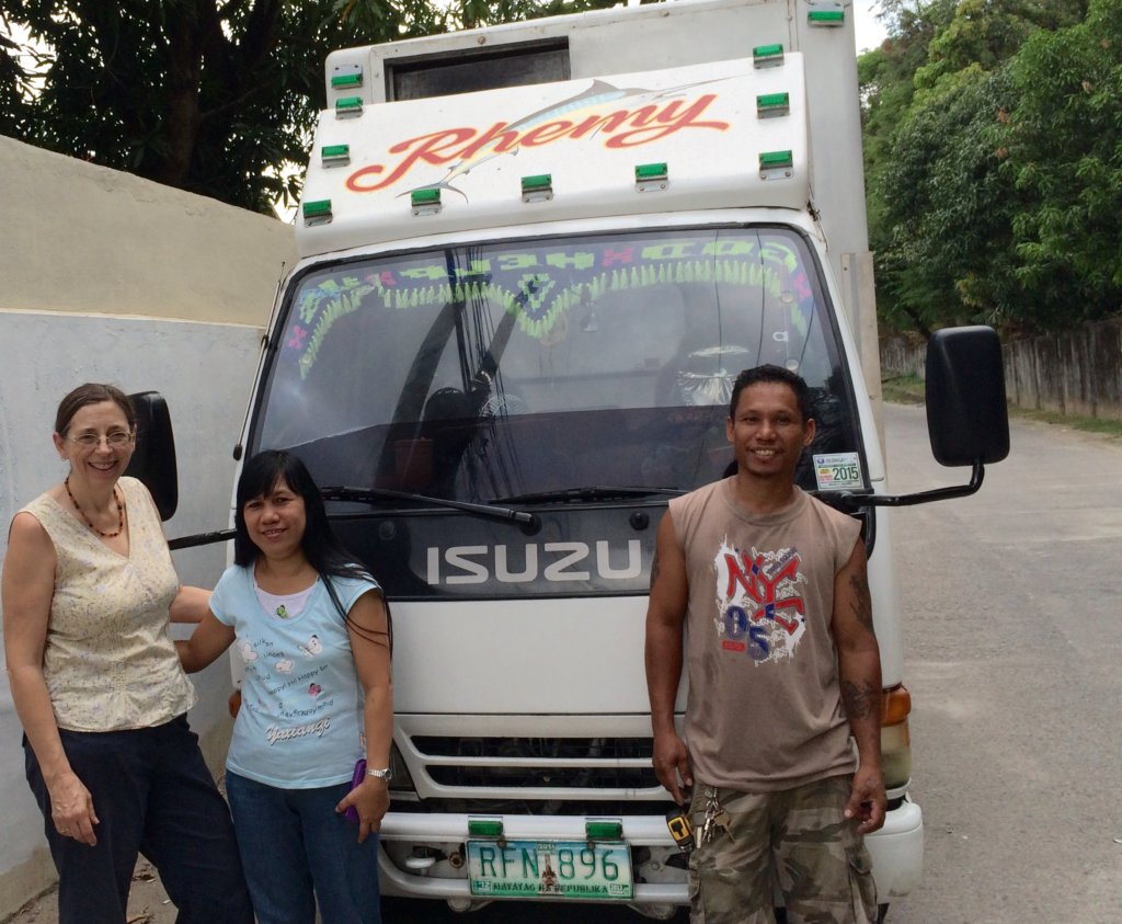 Vicki, Cecille & Tano; truck of medical supply