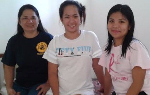 The Midwives with a patient on Mindoro island