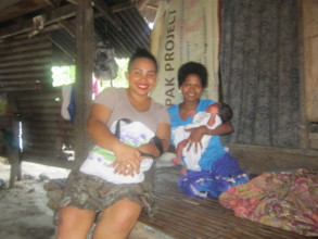 Midwives bring vitamins and clothes for newborn