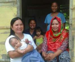 Meddie counsels on breastfeeding during home visit