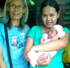 Midwife Imelda making a Post Partum Home Visit