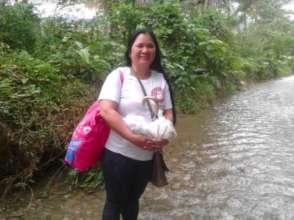 Walking thru floods to bring gifts of food