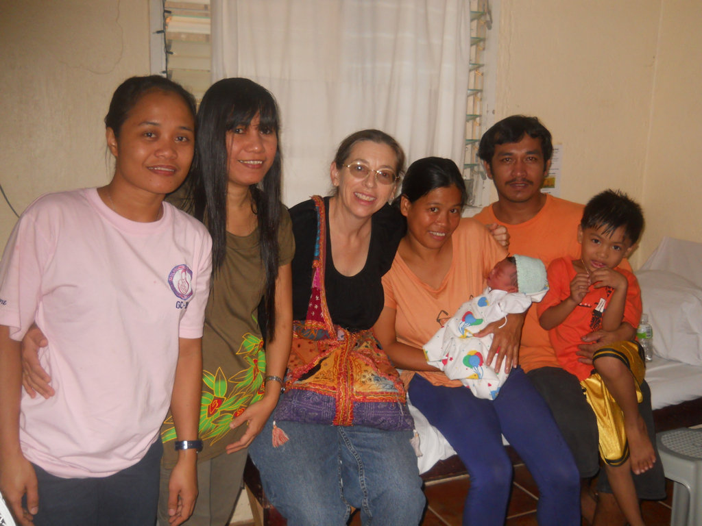 A happy new family surrounded by Mercy Midwives