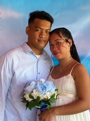 Masks are removed for official wedding photo